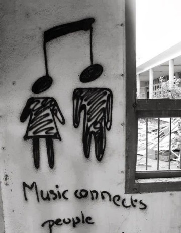 Beautiful-music-quote-on-a-wall - Copy